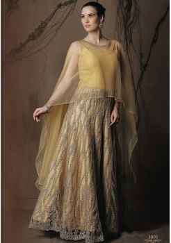 YELLOWISH GOLD CREAM ART SILK DESIGNER GOWN
