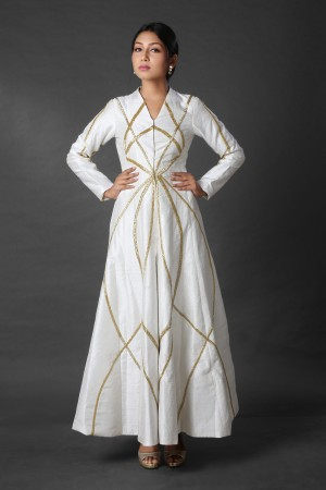 White jacket style dress with cut dana embroidery and white pant.